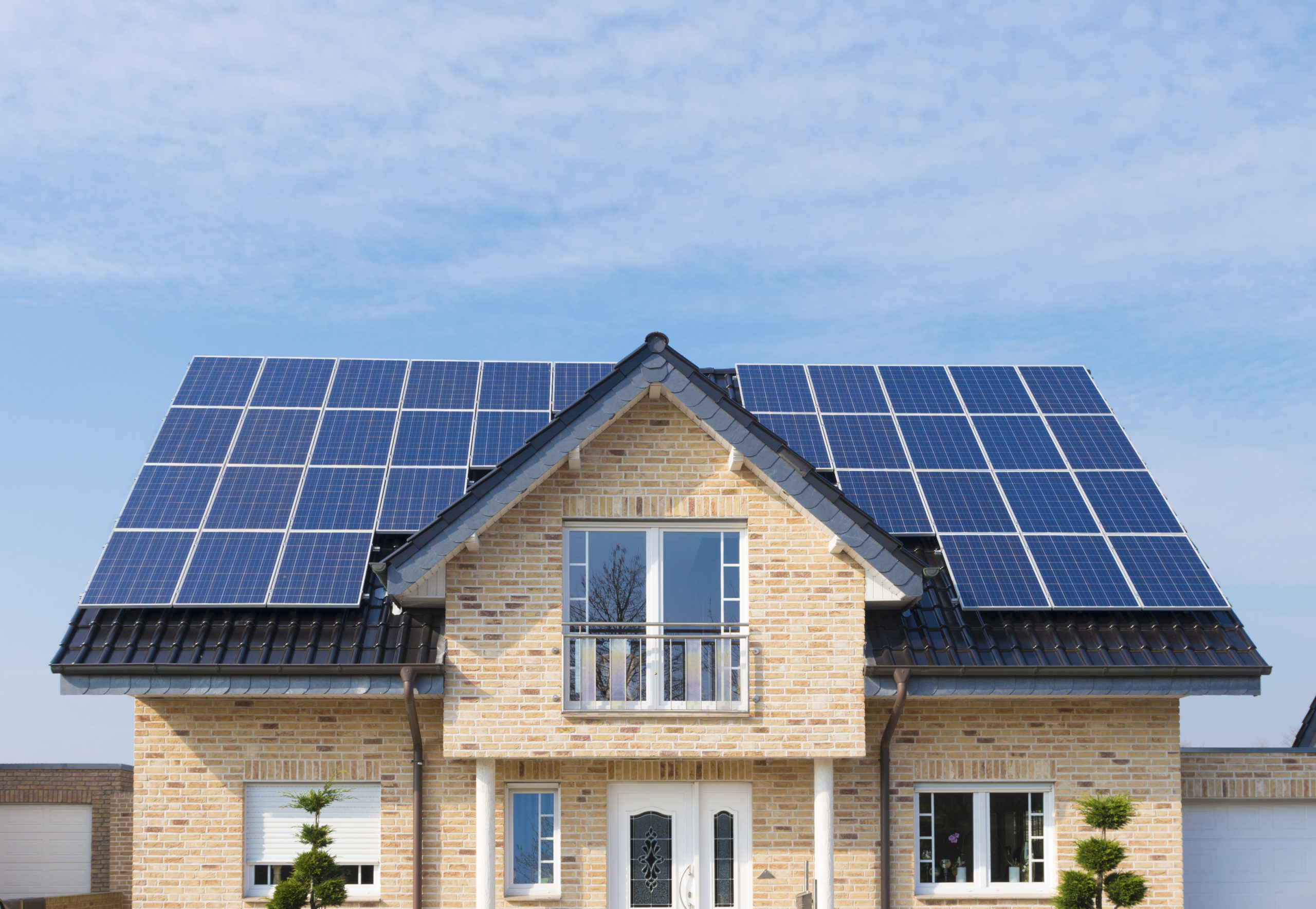 Gronau, Germany - March 6, 2014: New house with solar panels on its roof. In Germany solar energy is heavily subsidized by the government